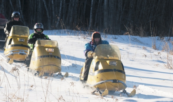 Vintage Snowmobile riders brave frigid temps