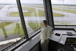 In this Aug. 2, 2005 photo, Neil Haines, facilities administration manger for the Loring Development Authority, looks out at the empty tarmac at the former Loring Air Force Base in Limestone, Maine. A group of science and space enthusiasts in 2018 want the state to become America's leader in sending tiny satellites into space. The tentative plan is to use former air bases as the project's home. The Loring base would serve as the launch site, while the former Naval Air Station Brunswick would house mission control.