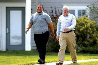 In this May 25, 2018, photo, Puerto Rican Anthony Rios, left, walks with Bob Smith, owner of Sebasco Harbor Resort in Phippsburg, Maine. Smith hired a half-dozen Puerto Ricans last summer for housekeeping, landscaping and kitchen work, providing relief to his overworked staff. This summer he is doubling the number, and he would like to hire even more.