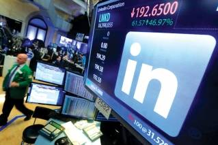 The LinkedIn logo appears on a screen at the post where it trades on the floor of the New York Stock Exchange. Microsoft broke out LinkedIn revenue when it reported its quarterly earnings Wednesday, Jan. 31, 2018.