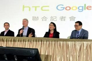 Senior vice president of hardware for Google Rick Osterloh, second from left, speaks during a press conference in New Taipei City, Taiwan, Thursday, Sept. 21, 2017. Google is biting off a big piece of device manufacturer HTC for $1.1 billion to expand its efforts to build phones, speakers and other gadgets equipped with its arsenal of digital services. With Osterloh is, from left, Mario Queiroz, vice president of product management at Google, Cher Wang, chairperson of HTC, and Chia-Lin Chang, president of smartphones and connected devices for HTC.