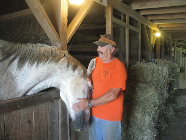 Nag A Bon Acres owner Mark Merrill is shown in his stable with one of his horses named Duncan. Now in its 30th year, his farm is home to 30 horses, most of which are rescue animals under his care.