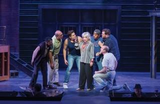"From left to right: Horse (Reggie Whitehead), Harold (Ronald Brown), Ethan (Ira Kramer), Jeanette (A.J. Mooney), Jerry (Daniel Kennedy), Dave (Ben Layman) and Malcolm (Dominick Varney Wood) struggle with the men's inability to learn how to dance in this scene from Penobscot Theatre Company's production of ""The Full Monty."""