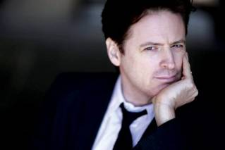 "Actor, comedian & broadcaster John Fugelsang hosts ""Page Six TV,"" which according to Fugelsang, looks at current pop culture events from a fresh point of view. His interview with George Harrison included persuading Harrison to play several songs on acoustic guitar, which proved to be Harrison's final televised appearance and was broadcast as ""The Last Performance."""