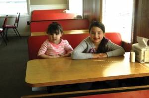 Olivia and Taylor Clark sit in a booth at the Corner Store (photo by Jodi Hersey)