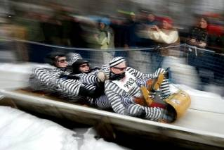 A four-man toboggan team called the Ray Bandits makes its first run during the U.S. Toboggan Championships, Saturday, Feb. 10, 2018, in Camden, Maine.