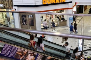 In this Aug. 7, 2019, photo shoppers ride an escalator inside the Glendale Galleria in Glendale, Calif.   If a threat of a recession gives you pause when it comes to your personal finances, remember now is a time to prepare, not panic. Financial experts say there a steps you can take now to brace yourself for any downturn ahead.