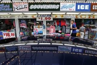 In this July 6, 2018, photo, a souvenir shop attracts tourists in Old Orchard, Beach, Maine. Canadians may be angry about President Donald Trump's insults and tariffs, but it doesn't seem to be taking a toll on tourism. In Old Orchard Beach, popular with Canadians from French-speaking Quebec, innkeepers report that tourism remains strong despite harsh words.