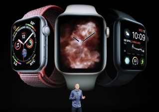 In this Sept. 12, 2018, file photo, Jeff Williams, Apple's chief operating officer, speaks about the Apple Watch Series 4 at the Steve Jobs Theater during an event to announce new Apple products in Cupertino, Calif. The latest software update to the newest Apple Watch, the Series 4, will now let people take EKGs of their heart and notify them when they have an irregular heartbeat.