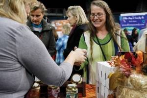 Attendees at last year's Maine Harvest Festival buy one of the many products available at the two-day event that features over one hundred vendors.