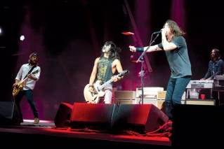 "Yayo Sanchez, AKA Kiss Guy, plays ""Monkey Wrench"" with Foo Fighters at an April 18 concert in Austin."