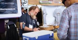 A representative of Tributary Brewing Company pours a sample for an attendee at the 2016 Summer Session Brew Fest at Thompson Point in Portland.