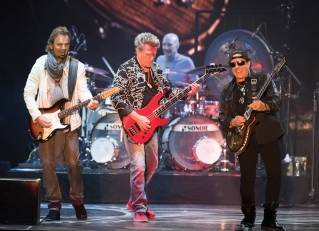 Journey members Jonathan Cain, left, Ross Valory, center, Neal Schon and drummer Steve Smith perform at the Darling's Waterfront Pavilion on Wednesday, June 22, 2016. The iconic band has been chosen for induction into the Rock and Roll Hall of Fame.