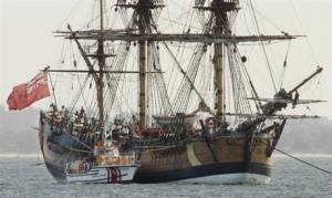 In this April 17, 2005 file photo, the Endeavour, a replica of Captain James Cook's ship of discovery, lies at anchor in Botany Bay at Sydney, Australia. Researchers believe the wreckage of the ship Cook used to explore around the world is submerged somewhere in Rhode Island's Newport Harbor. If it is the Endeavour, the ship would belong to the state of Rhode Island, because of the state's legal maneuver in maritime court nearly two decades ago based on an obscure, centuries-old maritime practice. (AP Photo/Mark Baker, File)