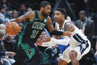 Boston Celtics guard Kyrie Irving, left, drives past Denver Nuggets guard Gary Harris in the first half of an NBA basketball game Monday, Jan. 29, 2018, in Denver.