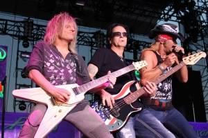 C.C. DeVille (guitar), Bobby Dall (Bass) and Bret Michaels of Poison