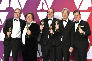 "Jim Burke, from left, Charles B. Wessler, Nick Vallelonga, Peter Farrelly and Brian Currie pose with the award for best picture for ""Green Book"" in the press room at the Oscars on Sunday at the Dolby Theatre in Los Angeles."