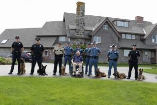President Bush poses with Maine State K9 Patrol School grads. The photo was taken at Walker's Point in Kennebunk.