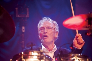 In this Sunday, Dec. 7, 2008 file photo, British musician Ginger Baker performs at the 'Zildjian Drummers Achievement Awards' at the Shepherd's Bush Empire in London. The family of drummer Ginger Baker, the volatile and propulsive British musician who was best known for his time with the power trio Cream, says he died, Sunday Oct. 6, 2019. He was 80.