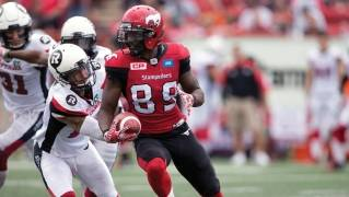 Devaris Daniels (No. 89) of the Calgary Stampeders breaks a tackle during his team's recent game against the Ottawa REDBLACKS.