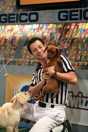 Dan Schachner, referee for Puppy Bowl XIII, introduces a couple of the players.