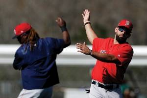 Boston Red Sox's Deven Marrero, right, and Hanley Ramirez warm up during a spring training baseball workout in Fort Myers, Fla., Sunday, Feb. 19, 2017.