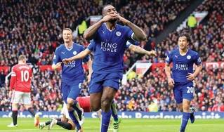 Leicester's Wes Morgan, center, celebrates after scoring during the English Premier League match between Manchester United and Leicester. (AP photo by Jon Super)