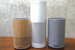 "In this Sept. 27, 2017, file photo, Amazon Echo Plus, center, and other Echo devices sit on display during an event announcing several new Amazon products by the company in Seattle. Amazon says an ""unlikely"" string of events prompted its Echo personal assistant device to record a Portland, Ore., family's private conversation and then send the recording to an acquaintance in Seattle."