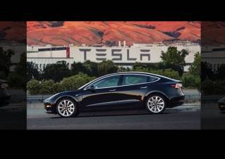 This undated image provided by Tesla Motors shows the Tesla Model 3 sedan. The electric car company's newest vehicle, the Model 3, which set to go to its first 30 customers Friday, July 28, 2017, is half the cost of previous models. Its $35,000 starting price and 215-mile range could bring hundreds of thousands of customers into Tesla's fold, taking it from a niche luxury brand to the mainstream.