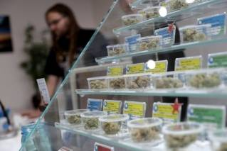 In this Dec. 29, 2017 photo, various kinds of marijuana strains are displayed at the KindPeoples dispensary in Santa Cruz, Calif. Californians may awake on New Year's Day to a stronger-than-normal whiff of marijuana as America's cannabis king lights up to celebrate the state's first legal retail pot sales.