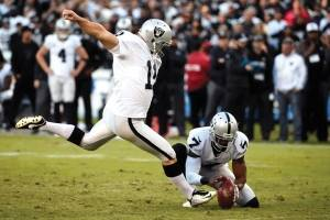 Oakland Raiders kicker Sebastian Janikowski kicks a field goal as Marquette King holds during the second half of an NFL football game against the San Diego Chargers Sunday, Dec. 18, 2016, in San Diego.