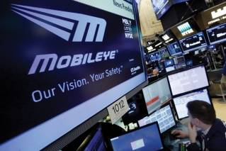 The Mobileye logo appears on a screen at the post where it trades on the floor of the New York Stock Exchange, Monday, March 13, 2017. Intel will buy Israel's Mobileye in a deal valued at just over $14 billion, the latest push by a major tech company to advance autonomous vehicles that could change the way traffic moves globally.