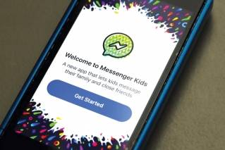 Facebook's Messenger Kids app is displayed on an iPhone in New York, Friday, Feb. 16, 2018. The app lets kids under 13 chat with friends and family, is ad-free and connected to a parent's account.