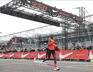 In this Saturday, May 6, 2017 file photo, Olympic marathon champion Eliud Kipchoge crosses the finish line of a marathon race at the Monza Formula One racetrack, Italy. Eliud Kipchoge was 26 seconds from making history on May 6. Nike and Adidas have announced separate plans to attack the 2-hour marathon, with both introducing shoe lines linked to the effort. Wireless tech giant Vodafone last month said it was backing a third bid, hoping data gleaned from the quest will translate into wearable technology.
