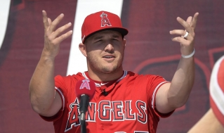Los Angeles Angels center fielder Mike Trout gestures during a news conference to talk about Trout's 12-year, $426.5 million contract, prior to the team's exhibition baseball game against the Los Angeles Dodgers on Sunday, March 24, 2019, in Anaheim, Calif.