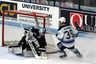 UMaine right wing Joey Diamond sprays ice after UNH goalie Casey DeSmith stops the puck in the first period of play on Saturday, March 3 at Alfond Arena.