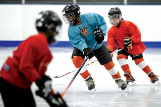 In this Feb. 21, 2019 photo Malakye Johnson takes part in a Snider Hockey practice at the Scanlon Ice Rink in Philadelphia.