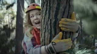 This photo provided by Kia Motors America shows a scene from the company's spot for Super Bowl 51. Melissa McCarthy humorously takes on political causes like saving whales, ice caps and trees, each time to disastrous effect, in Kis's 60-second ad to promote the fuel efficiency of its 2017 Niro crossover.