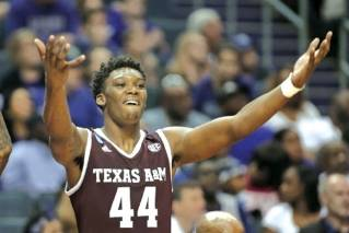 Texas A&M's Robert Williams celebrates on the bench during a March 18 NCAA Tournament game against North Carolina in Charlotte, N.C. The Boston Celtics selected Williams in the first round of Thursday's NBA draft.