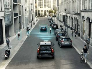 This undated photo rendering provided by Volvo Cars shows the car makers City Safety feature in one of their XC90 SUVs. City Safety features pedestrian and cyclist detection with full auto brake, day and night.