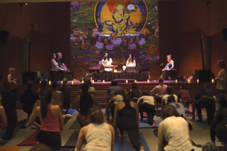 "This Jan. 20, 2017, photo provided by the Rubin Museum of Art shows yoga participants in ""Swear In, Breathe Out,"" a special yoga class offered in response to Inauguration Day at the Rubin Museum in New York. The class was taught by Sarah Platt-Finger, accompanied by live music from Aya & Tyler."