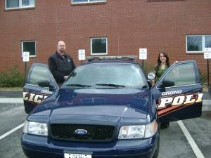 Decetive Derek Dinsmore (left) and Sarah Exley (right) outside of the Orono Police Department.