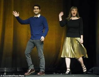 "Kumail Nanjiani, left, and his wife Emily Gordon, the co-writers of the upcoming film ""The Big Sick,"" are introduced onstage during the Amazon Studios presentation at CinemaCon 2017 at Caesars Palace on Thursday, March 30, 2017, in Las Vegas. Nanjiani also stars in the film."