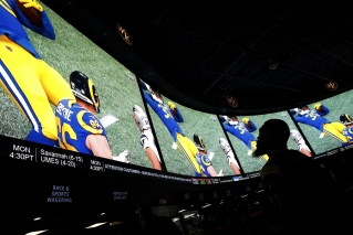 A man watches Super Bowl LIII at the Westgate Superbook sports book in Las Vegas on Feb. 3, 2019.