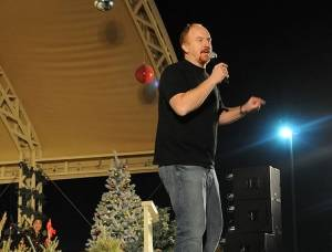 Comedian Louis C.K. performs for servicemembers at the Zone 6 Morale, Welfare and Recreation Stage during the Sergeant Major of the Army Hope and Freedom Tour 2008, Camp Arifjan Kuwait, Dec. 18, 2008.