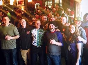In this photo from Saturday, April 1, 2017, Tim Gallon (left), owner of Black Bear Brewing, Asa March-Sachs, brewmaster at Orono Brewing Company, Abe Furth, owner of Orono Brewing, Clay Randall of Marsh Island Brewing, and Mark Horton and Heather Furth of Orono Brewing stand in front of a crowd celebrating the release of Block Party IPA at Black Bear Brewing in Orono. The beer was a collaboration between the three breweries.