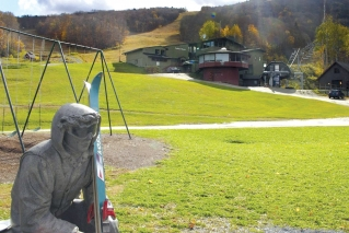 In this Oct. 23, 2019, photo, a sculpture of a skier and slopes, rear, await the ski season at Sugarbush Resort in Warren, Vt. In the tight labor market, ski areas are having a tough time hiring seasonal workers so they're upping the ante by boosting wages, offering more worker housing and other incentives.
