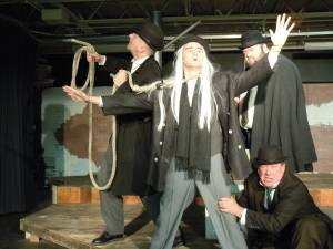 "Lucky (Tyler Costigan) holds forth as Vladimir (Jim Bulteel), Pozzo (Tellis Coolong) and Estragon (Christopher Luthin) look on in Stillwater Stage's production of ""Waiting for Godot."""