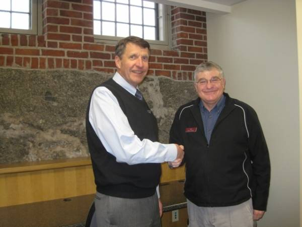 John Witherspoon, president of Skowhegan Savings Bank, and Dale Jandreau, director of Skowhegan Free Public Library, meet in the newly renovated basement area of the library.