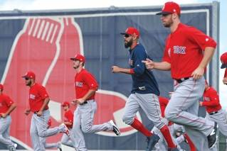 Red Sox pitchers run during Spring Training at the Player Development Complex on Wednesday, February 21, 2018.